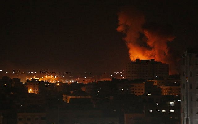 Illustrative: Smoke rises from an explosion caused by an Israeli airstrike on Gaza City, on October 27, 2018. (AP Photo/Adel Hana)