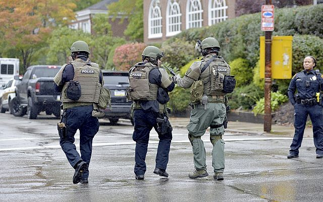 Police respond to an active shooter situation at the Tree of Life synagogue on Wildins Avenue in the Squirrel Hill neighborhood of Pittsburgh, Pennsylvania, on Saturday, October 27, 2018. (Pam Panchak/Pittsburgh Post-Gazette via AP)