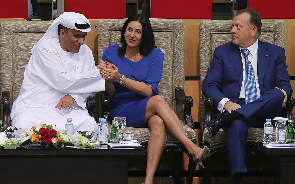 Israeli Culture and Sport Minister Miri Regev, middle, shakes hands with Mohamed Bin Tha'loob Al Derai, President of UAE Wrestling Judo & Kickboxing Federation, after one Israeli player won the bronze medal during the Abu Dhabi Grand Slam Judo tournament in Abu Dhabi, United Arab Emirates, Saturday, Oct. 27, 2018. (AP/Kamran Jebreili)