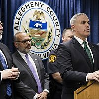United States Attorney Scott Brady, at podium, speaks with members of the media during a news conference in the aftermath of a deadly shooting at the Tree of Life Synagogue in Pittsburgh, Sunday, Oct. 28, 2018. (AP Photo/Matt Rourke)