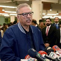 Pakistan's President Arif Alvi talks to journalists prior to departing to Turkey on a three-day visit, in Islamabad, Pakistan, October 28, 2018. (Press Information Department via AP)