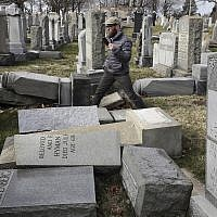 Rabbi Joshua Bolton of the University of Pennsylvania's Hillel center surveys damaged headstones at Mount Carmel Cemetery in Philadelphia, on February 27, 2017. (AP Photo/Jacqueline Larma, File)