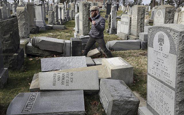 Rabbi Joshua Bolton of the University of Pennsylvania's Hillel center surveys damaged headstones at Mount Carmel Cemetery in Philadelphia, on February 27, 2017. (AP Photo/Jacqueline Larma, File)