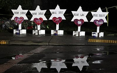 Stars of David with names of those killed in a shooting at the Tree of Life Synagogue in Pittsburgh, at a memorial outside the synagogue, Sunday, Oct. 28, 2018. (AP Photo/Gene J. Puskar)