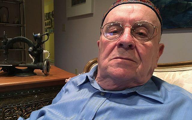 In this October 29, 2018 photo, Holocaust survivor Judah Samet, 80, sits in his living room in Pittsburgh. (AP Photo/Allen G. Breed)