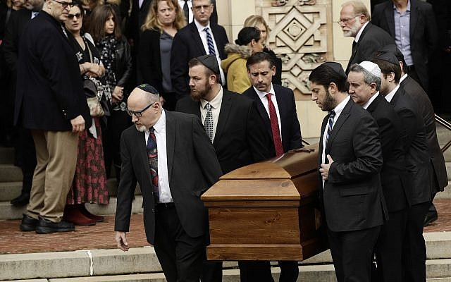 A casket is carried out of Rodef Shalom Congregation after the funeral services for brothers Cecil and David Rosenthal,  in Pittsburgh, October 30, 2018. (Matt Rourke/AP)