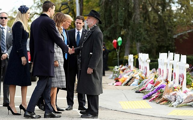 Jared Kushner, left, greets Tree of Life Rabbi Jeffrey Myers, right, as US President Donald Trump and First Lady Melania Trump arrive outside the Tree of Life Synagogue in Pittsburgh, Pennsylvania, October 30, 2018. (AP Photo/Andrew Harnik)
