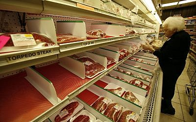 Illustrative: A customer shops at a kosher butcher shop in North Miami Beach, Florida, on Nov. 25, 2008. (AP Photo/Wilfredo Lee)