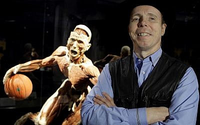 Doctor Gunther von Hagens, anatomist, inventor of and creator of Body Worlds, is seen in front of one of his works in Istanbul, Turkey, Friday, June 11, 2010 (AP Photo/Ibrahim Usta)