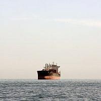Illustrative -- A cargo ship is seen between Iranian city port of Bandar Abbas and Qeshm island in the strategic water way of Persian Gulf, on Dec. 23, 2011. (AP Photo/Vahid Salemi)