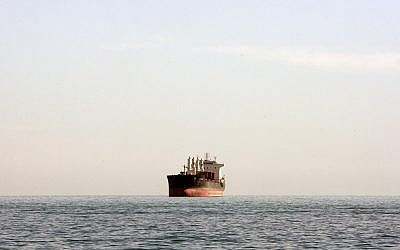 Illustrative -- A cargo ship is seen between Iranian city port of Bandar Abbas and Qeshm island in the strategic water way of Persian Gulf, on Dec. 23, 2011. (AP Photo/Vahid Salemi)