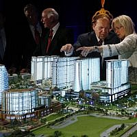 Las Vegas Sands Chairman and CEO Sheldon Adelson, second right, and his wife, Miriam Ochsorn, right, look at a model of the Sands Cotai Central resort during a news conference in Macau on Wednesday, April 12, 2012. (AP /Kin Cheung)