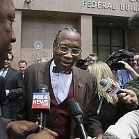 Reporters try to interview Dallas County Commissioner John Wiley Price as he exits federal court in downtown Dallas, on April 28, 2017. (AP Photo/LM Otero/File)