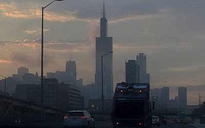 Illustrative: Early commuters drive as the sun rises over the Chicago skyline Friday, June 30, 2017. (AP Photo/G-Jun Yam)