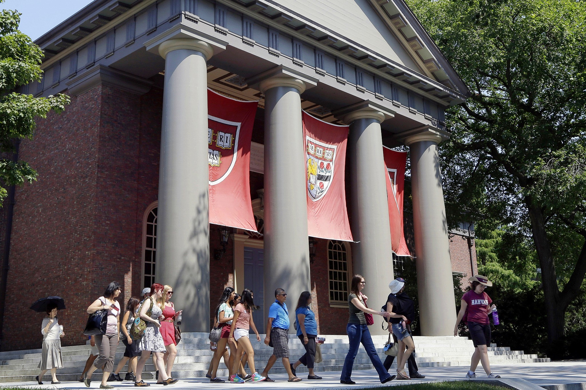 Atour group walks through the campus of Harvard University in Cambridge Mass. Word of an August 2017 Justice Department inquiry into how race factors into admissions at Harvard University has left top-tier colleges bracing for scrutiny of practices that