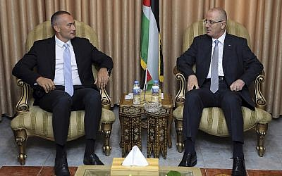 Palestinian Authority Prime Minister Rami Hamdallah, right, and United Nations Special Coordinator for the Middle East Peace Process Nickolay Mladenov meet at PA President Mahmoud Abbas' former official residence in Gaza City, on October 3, 2017. (AP Photo/Prime Minister Office)