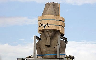 A drone films a giant statue of the pharaoh Ramses II as it is relocated at the Grand Egyptian Museum, in Cairo, Egypt, January 25, 2018. (Amr Nabil/AP)