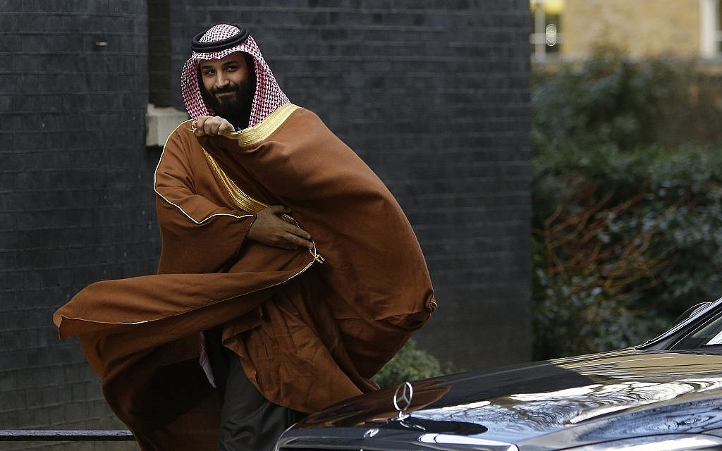 Saudi Arabia's Crown Prince Mohammed bin Salman walks to greet Britain's Prime Minister Theresa May outside 10 Downing Street in London, Wednesday, March 7, 2018. (AP/Alastair Grant)