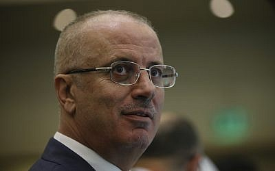 Palestinian Authority Prime Minister Rami Hamdallah during a joint news conference with Turkey's President Recep Tayyip Erdogan in Istanbul, May 18, 2018. (AP Photo/Emrah Gurel)