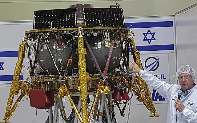 "Opher Doron, general manager of Israel Aerospace Industries' space division, speaks beside the SpaceIL lunar module, in a special ""clean room"" where the space craft is being developed, during a press tour of their facility near Tel Aviv, Israel, July 10, 2018. (AP Photo/Ilan Ben Zion)"