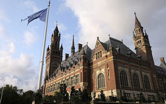The United Nations flag flutters in the wind next to the International Court of Justice in the Hague, the Netherlands, August 27, 2018. (AP Photo/Mike Corder)