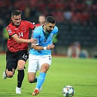 Albania's Taulant Xhaka,, left, fights for the ball with Israel's Munas Dabbur during the UEFA Nations League soccer match between Albania and Israel at Elbasan Arena, in Elbasan, southern Albania, Friday, Sept. 7, 2018. (AP Photo/Hektor Pustina)