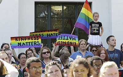 Counter protesters stand outside the Mobile Public Library to support the Drag Queen Story Hour in Mobile, Alabama, on September 8, 2018. (AP Photo/Dan Anderson)