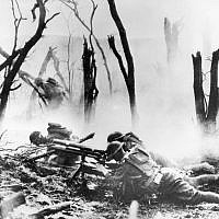 In this September 26, 1918, photo, a US Army 37-mm gun crew man their position during the World War One Meuse-Argonne Allied offensive in France. (AP Photo, File)