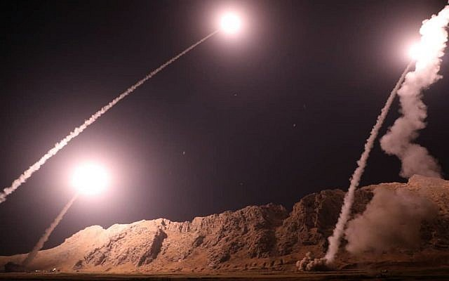 In this photo released on Oct. 1, 2018, by the Iranian Revolutionary Guard, missiles are fired from city of Kermanshah in western Iran targeting the Islamic State group in Syria (Sepahnews via AP)