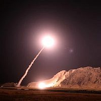 In this photo released on October 1, 2018, by the Iranian Revolutionary Guard Corps, a missile is fired from city of Kermanshah in western Iran targeting the Islamic State group in Syria. (Sepahnews via AP)