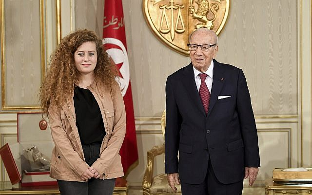 Tunisian President Beji Caid Essebsi, right, greets Palestinian activist Ahed Tamimi at the presidential palace, in Carthage near Tunis, Tunisia, October 2, 2018 (Hassene Dridi/AP)