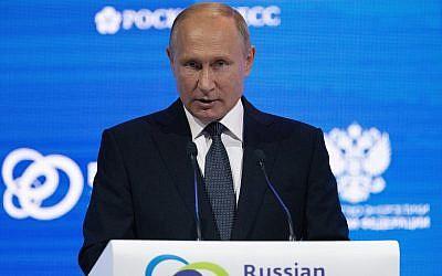 Russian President Vladimir Putin speaks at the Russian Energy Week International Forum in Moscow, Russia, October 3, 2018. (AP Photo/Alexander Zemlianichenko, Pool)