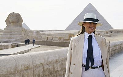 First lady Melania Trump visits the ancient statue of Sphinx, with the body of a lion and a human head, at the historic site of Giza Pyramids in Giza, near Cairo, Egypt, Oct. 6, 2018 (AP Photo/Carolyn Kaster)