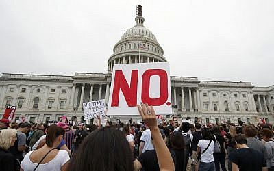 Activists demonstrate in the plaza of the East Front of the US Capitol to protest the confirmation vote of Supreme Court nominee Brett Kavanaugh on Capitol Hill, Oct. 6, 2018 in Washington. (AP Photo/Alex Brandon)