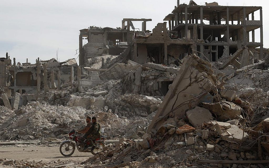 Clearing the rubble in Syria's Palestinian Yarmouk camp