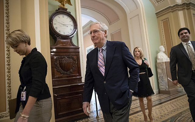 Senate Majority Leader Mitch McConnell, R-Ky., walks to the chamber for the final vote to confirm Supreme Court nominee Brett Kavanaugh, at the Capitol in Washington, Oct. 6, 2018. (AP Photo/J. Scott Applewhite)