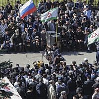 People attend a protest against the new land swap deal agreed by the heads of the Russian regions of Ingushetia and Chechnya, in Ingushetia's capital Magas, Russia, Oct. 8, 2018 (AP Photo/Musa Sadulayev)
