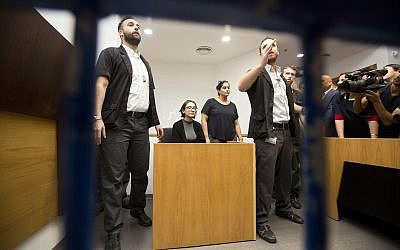 American Lara Alqasem, center, sits in a courtroom prior to a hearing at the district court in Tel Aviv, Israel, Thursday, Oct. 11, 2018.(AP Photo/Sebastian Scheiner)