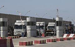 Israeli trucks carrying diesel fuel enter Kerem Shalom cargo crossing on the Israel-Gaza border, October 11, 2018. (AP Photo/Tsafrir Abayov)
