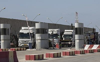 Israeli trucks carrying diesel fuel enter Kerem Shalom cargo crossing on the Israel Gaza border