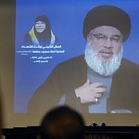 Hezbollah leader Hassan Nasrallah speaks via a video link, in Beirut, Lebanon, Friday, October 12, 2018 (AP Photo/Hussein Malla)