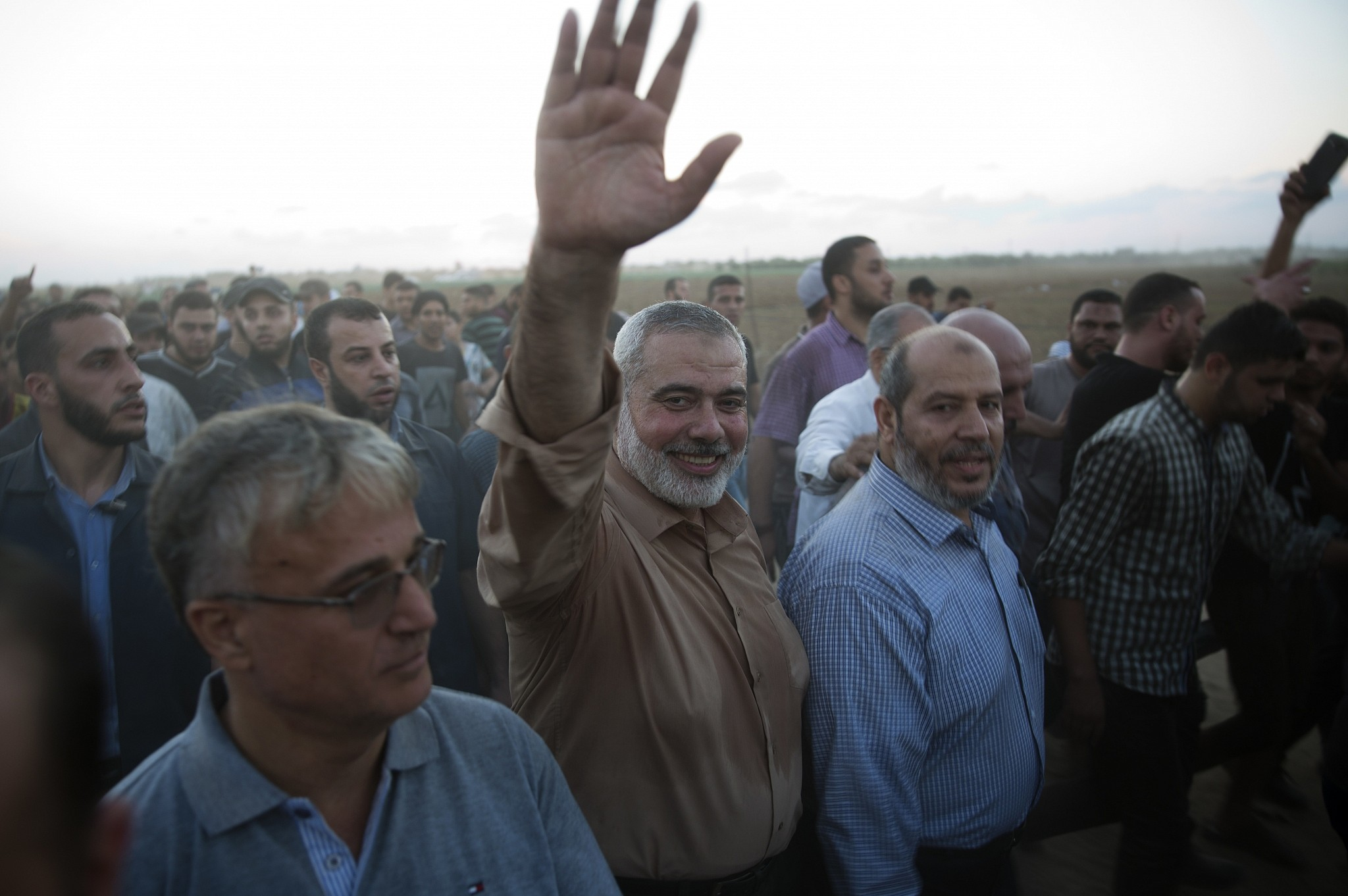 Palestinian Hamas top leader Ismail Haniyeh waves to protesters during a protest at the Gaza Strip's border with Israel Oct. 12 2018