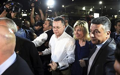 Pastor Andrew Brunson, center left, and his wife Norine Brunson arrive at Adnan Menderes airport for a flight to Germany after his release following his trial in Izmir, Turkey, Oct. 12, 2018 (AP Photo/Emre Tazegul)