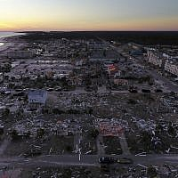 Damaged homes are seen along the water's edge in the aftermath of hurricane Michael in Mexico Beach, Florida, Oct. 12, 2018. (AP Photo/David Goldman)