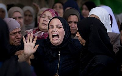 Relatives of Aisha Rabi mourn at the family home during her funeral in the West Bank village of Biddya, October 13, 2018. (AP Photo/Majdi Mohammed)