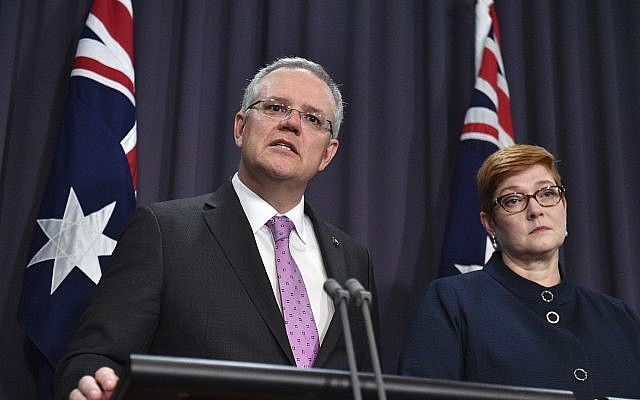 Prime Minister Scott Morrison, left, speaks to the media alongside Minister for Foreign Affairs Marise Payne at the Parliament House in Canberra, October 16, 2018. (Mick Tsikas/AAP Image via AP)