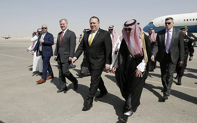 US Secretary of State Mike Pompeo, second right in front, walks with Saudi Foreign Minister Adel al-Jubeir after arriving in Riyadh, Saudi Arabia, Oct. 16, 2018. (Leah Millis/Pool Photo via AP)