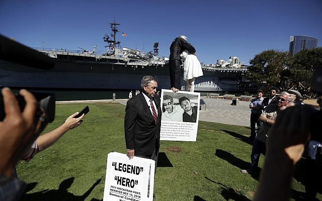 Former congressman Duncan L. Hunter, center, the father of indicted US Rep. Duncan Hunter, speaks at a news conference in support of his son, Oct. 16, 2018, in San Diego (AP Photo/Gregory Bull)