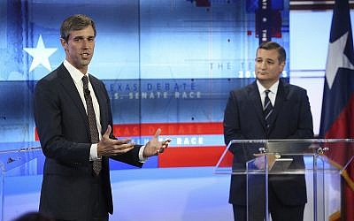 US Rep. Beto O'Rourke, D-Texas, left, and US Sen. Ted Cruz, R-Texas, right, take part in a debate for the Texas US Senate, Tuesday, October 16, 2018, in San Antonio. (Tom Reel/San Antonio Express-News via AP, Pool)