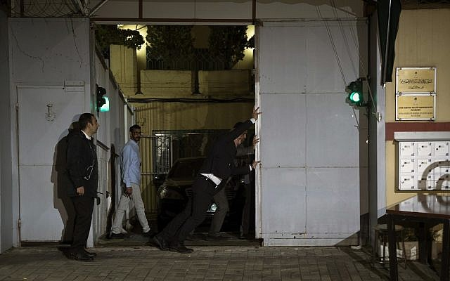 Consulate staff open the back door of the Saudi Consulate in Istanbul, Wednesday, Oct. 17, 2018. (AP/Petros Giannakouris)